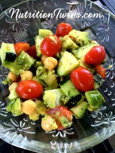 Tomato, Cucumber, Avocado, & Chickpea Salad   Only 120 Calories   Creamy, Sweet & Crunchy  Great way to eat less at meal  For Nutrition & Fitness Tips & MORE RECIPES please SIGN UP for our FREE NEWSLETTER www.NutritionTwins.com