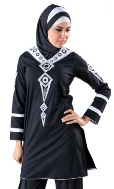 Design finesse is what comes to mind instantly when you see this garment. Featured here is a beautiful but modest kurti. Created out of a black 100% cotton poplin fabric this kurti is a one of its kind as it is available only in this jet black depicted here. It is adorned with a white piping at the borders, a block design pattern at the cuffs and unique designs at the arms and at the front of the garment.