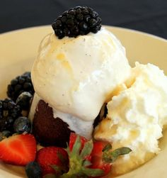 Mini Ghiradelli Chocolate Chip Brownie - with vanilla bean ice cream, fresh whipped cream, house caramel sauce and fresh berries