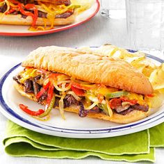 Philly Cheesesteaks Recipe -Any kind of steak makes my husband happy. Philly cheesesteaks are a nice dinner choice or a great option instead of burgers. —Susan Seymour, Valatie, New York
