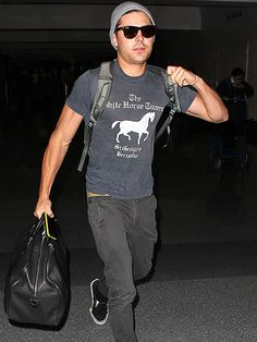 No assistance necessary! Zac Efron puts his buff biceps to work, handling his own bags on Thursday, before catching a flight out of LAX.