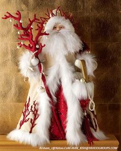 Adorable! I love feather boa's, felt, ornament face.....I see another inspirational piece to be made......
