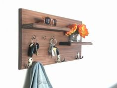 Keep your home stylishly organized with this floating shelf coat rack, a Midnight Woodworks original design. Our handcrafted entryway organizer is an excellent entryway storage solution. Perfect for keys, coats, backpacks and other necessities! This custom built flush-mount