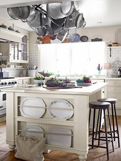 Zinc-topped kitchen island with built-in #storage.