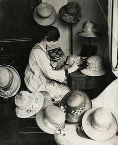 .Hat designer painting hats, Kensington, England, 1919