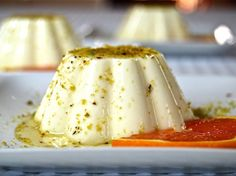 Panna Cotta is an Italian classic and has many variations. This version with an orange sauce and Sicilian Bronte pistachios, evokes flavors of South Italy.