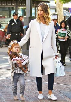 Jessica Alba went for a polished look in a classic cream coat // chic mom style
