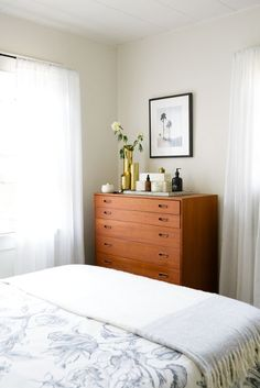 Midcentury teak dresser in pretty, relaxed bedroom