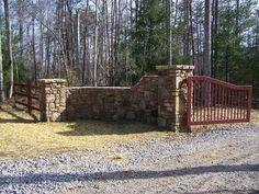 gated driveway entrance ideas | Stone & Iron Gate Driveway Entry