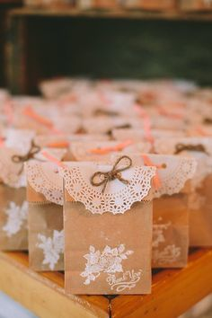 super cute paper bag and doily wedding favor bags