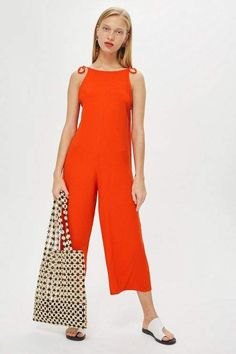 e32f4c5140c07 Topshop Bow slouch jumpsuit. This jersey ribbed jumpsuit features a cropped  wide leg and bow