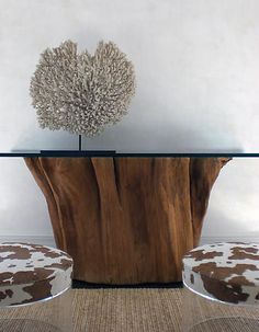 Great idea if you can source a tree trunk base, could also make a coffee table, side table or garden table. Just need to clean and treat the base and purchase a pice of toughened glass.