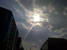 Sun peeking from behind clouds