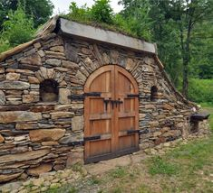 Gorgeous stone faced root cellar with custom door. Gorgeous stone faced root cellar with custom door Stone Cottages, Stone Houses, Stone Masonry, Root Cellar, Underground Homes, Earth Homes, Natural Building, Earthship, Spring Home