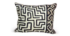 Pillow made from vintage African Kuba cloth with linen back and rust-colored cord detail.