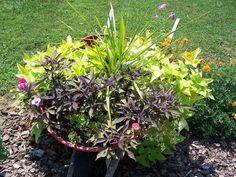 Wheel barrow flower planter