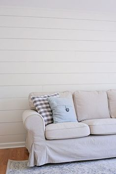 DIY Shiplap Accent Walls for the living room. How to easily and cheaply install faux shiplap walls to create a feature accent wall. A Cozy farmhouse style living room!
