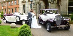 Amy and Mark oblige for a photo with the cars prior to a champagne reception with their guests at Kilworth House Hotel Lutterworth