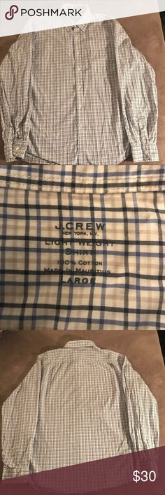 """J Crew Light Weight Long Sleeve Button Down There's nothing quite like a well-worn oxford (and few shirts age better—the frays, the fades...these are the kinds of details we love). Not only is it comfortable, it's the perfect way to nail the """"I have a yacht"""" look. This one is made in a lightweight fabric with a looser weave that works particularly well during summertime heat waves.  Cotton. Button-down collar. Size Large  Neck 16 Chest 22 Shoulder 18 Sleeve 26 Waist 21 1/2 Hem 21 1/2 Cuff 5…"""