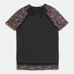 Mini skulls are unexpectedly paired with colorful florals on an intricate, piece-constructed design. Tailored with a playful mix of printed Italian fabrics, it features the dark edge of black grosgrain details and the sheer whimsy of an organza cutout at the neckline.