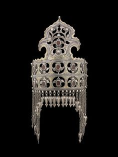 Central Asia | Yomud Turkoman Diadem.  Partly fire-gilded silver and carnelian | Rare example of a married woman's headdress crowned with a distinctive feature ~ stylized bird heads | From the Colette and Jean-Pierre Ghysels Collection