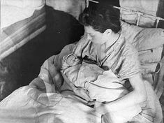 A mother holds her newborn baby in the Kovno (Lithuania) Ghetto hospital. A Jewish star is sewn onto the child's blanket, marking the baby for probable death just minutes after he or she was born. Of the 30,000 original residents of the Kovno Ghetto, which was established in the summer of 1941, less than 10% survived.