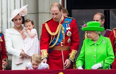 The caring Queen had a look of concern as her great-grandchild Prince George leant over the balcony at Buckingham Palace to catch a glimpse of the crowds below. Prince William acted fast and gently pulled his son back and later knelt down to explain the RAF flypast
