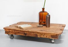 Industrial coffee table on cast iron wheels