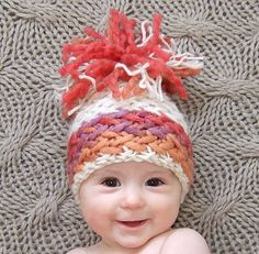 Knitted baby hat- I think the chunky yarn is just weaved in after the hat is complete