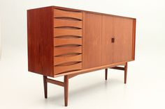 Medium high credenza in teak with roll front and drawers. Designed by Arne Vodder in the 1950s and manufactured by Sibast Møbler, Denmark. www.reModern.dk