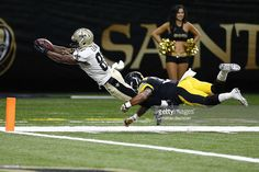 Tommylee Lewis #87 of the New Orleans Saints dives for a touchdown as Jordan Dangerfield #37 of the Pittsburgh Steelers attempts to tackle during the second half of a game at the Mercedes-Benz Superdome on August 26, 2016 in New Orleans, Louisiana.