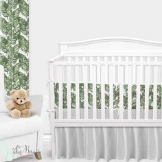 Palm leaf baby bedding, with a twist. This white and emerald green baby bedding set is simple yet sophisticated. We adore the watercolor brushstroke palm leaf print with a white background. This look has us feeling like we're in a tropical rainforest nursery.