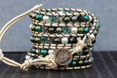 chan luu style wrap bracelet- blue, green and gray glass pearls and crystals on silver white leather. $55.00, via Etsy.