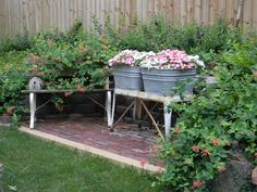 old antiques in flower gardens | My sons know I like old wagons and wheelbarrows, so my oldest one ...