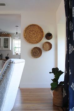 Try decorating with items that also have a purpose in your home. Crates, baskets and bins come in many colors, patterns and textures, so show them off! We love hanging baskets and woven trays as wall art for a natural focal point, it also keeps them handy Home Decor Baskets, Basket Decoration, Baskets On Wall, Hanging Baskets, Decorative Wall Baskets, Laundry Baskets, Retro Home Decor, Cheap Home Decor, Diy Home Decor