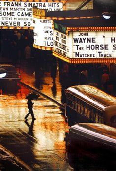 Pedestrian in rain on 42nd Street, New York City by Glinn Burt