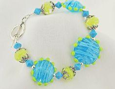 http://lhbeads.com/wp-content/gallery/bracelets/aqua-lime-bracelet.gif