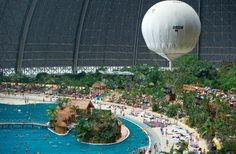Tropical Islands Resort, the world's largest indoor water park. Located near Berlin, Germany, in a huge dome originally built to be an airplane hangar, it features over 500 varieties of plants and a stainless steel pool large enough to accommodate 8,000 visitors a day. http://www.tropical-islands.de/en/attractions/