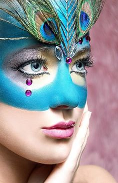 """Peacock: I love the """"fake mask"""" look here where the mask look is achieved with face paint and face decoration. I just feel like it gives a better line."""