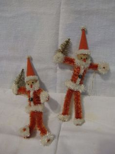 5 vintage 1940's chenille santa ornaments w/clay faces occupied