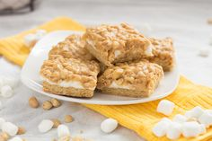Recipe for Salted Peanut Marshmallow Bars. Easy to make and tastes similar to Payday Candy Bars. Great for afternoon snacks and lunchbox treats! Healthy Afternoon Snacks, Yummy Snacks, Healthy Desserts, Dessert Bars, Dessert Recipes, Bar Recipes, Copycat Recipes, Dessert Ideas, Payday Candy Bar