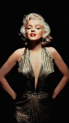 Marilyn Monroe stunning in a sleek gold gown.