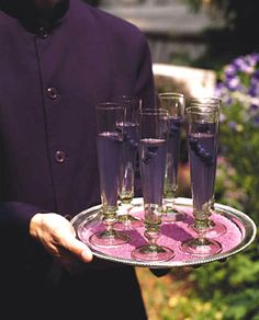 Brides Magazine: A Purple Party : Wedding Food & Drinks Gallery For the reception's signature cocktails, we add a touch of grape juice and a handful of blueberries to flutes of champagne. Cheers, Purple Party, Purple Wedding, Dream Wedding, Gothic Wedding, Wedding Music, Wedding Colors, Purple Cocktails, Colorful Cocktails