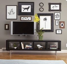 Nice display of art/tv. Love the table underneath too.