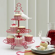 This three tier cupcake stand is the perfect vehicle to display delicious and beautifully decorated cakes, biscuits and pastries. Made from red coated metal, the stand has a Christmas tree handle for easy carrying to the dining or coffee table. Perfect for the festive season and an ideal table centrepiece for afternoon tea parties, birthdays or any special occasion.