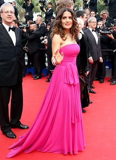 Salma Hayek wears a fuchsia chiffon gown by Saint Laurent to the premiere of The Prophet at the Cannes Film Festival