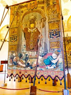 St. Ambrose, here on a tapestry in Milan's Sforza Castle museum, is the city's patron saint