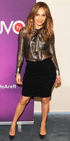 Jennifer Lopez shimmered in an iridescent blouse tucked into a black pencil skirt. The finishing touch? Studded pointy-toe pumps.