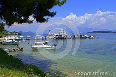 Motorboats moored at Lefkada island bay, beautiful summer sky and pure water,Greece