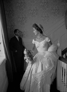 September 12, 1953 - A tiara made of lace, decorated w/ orange blossoms in the traditional form, was used to tie the veil to her hair. White & pink gardenias & orchids were arranged in Jacqueline's bouquet.